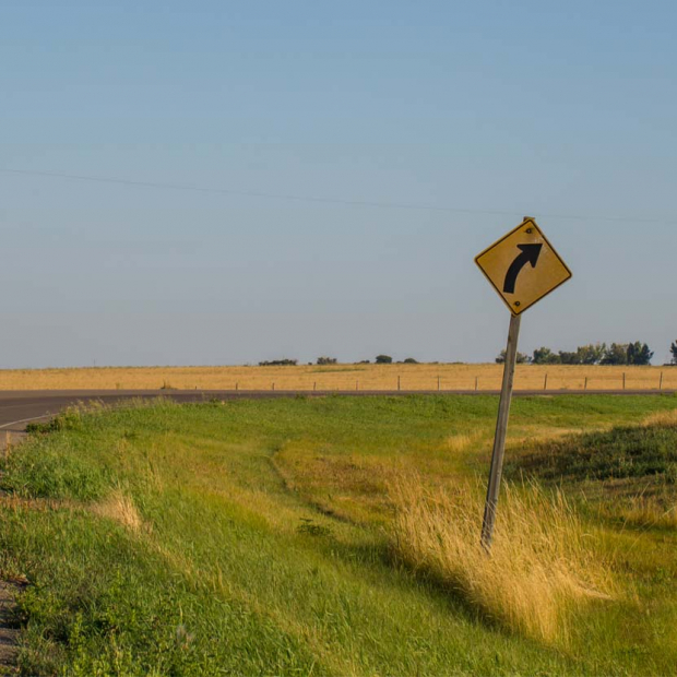 Rural highway with caution sign